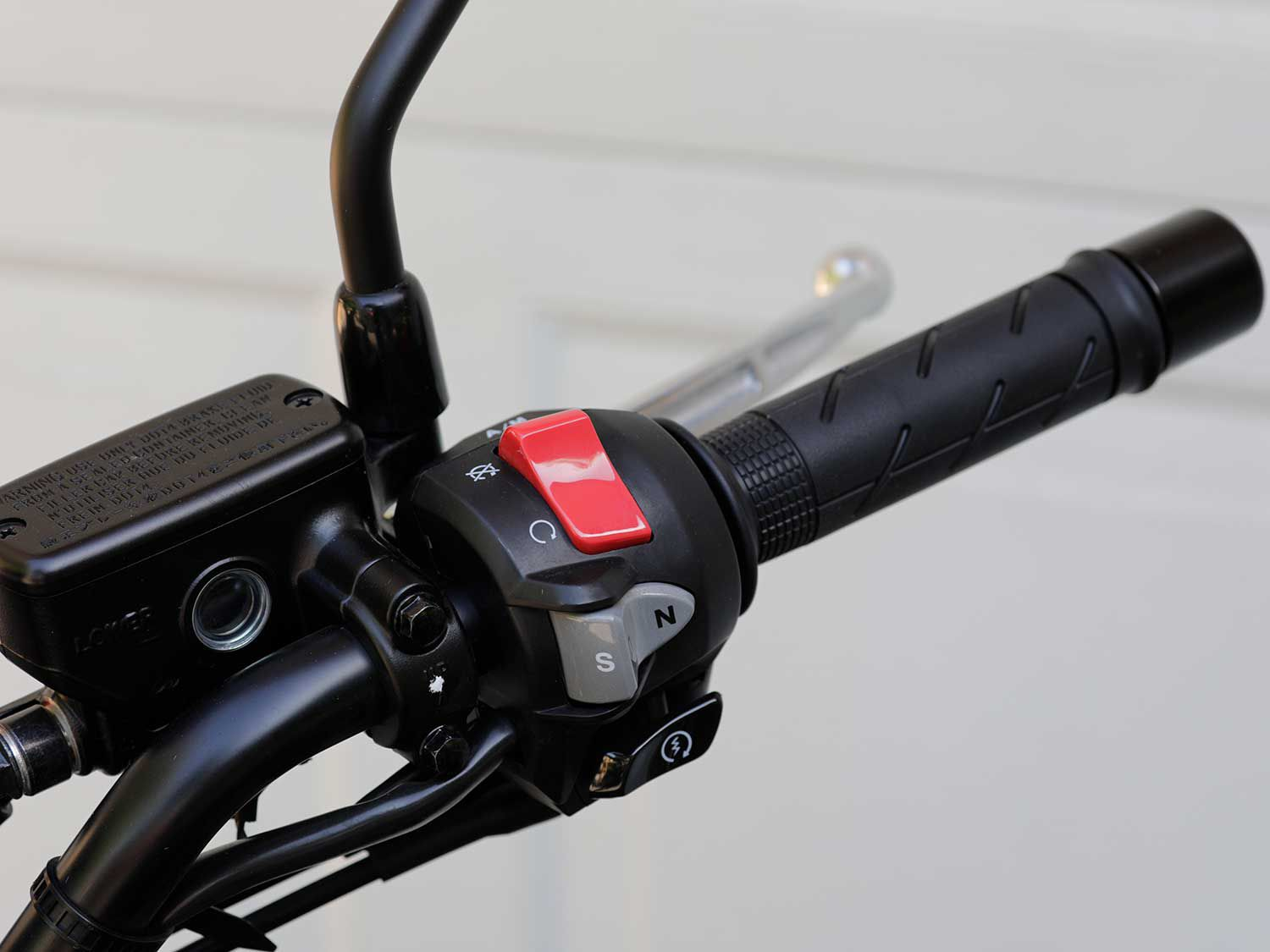 We test rode Honda's DCT-equipped NC750X which deletes the manual clutch and gearshift lever for this handlebar-mounted switch gear.