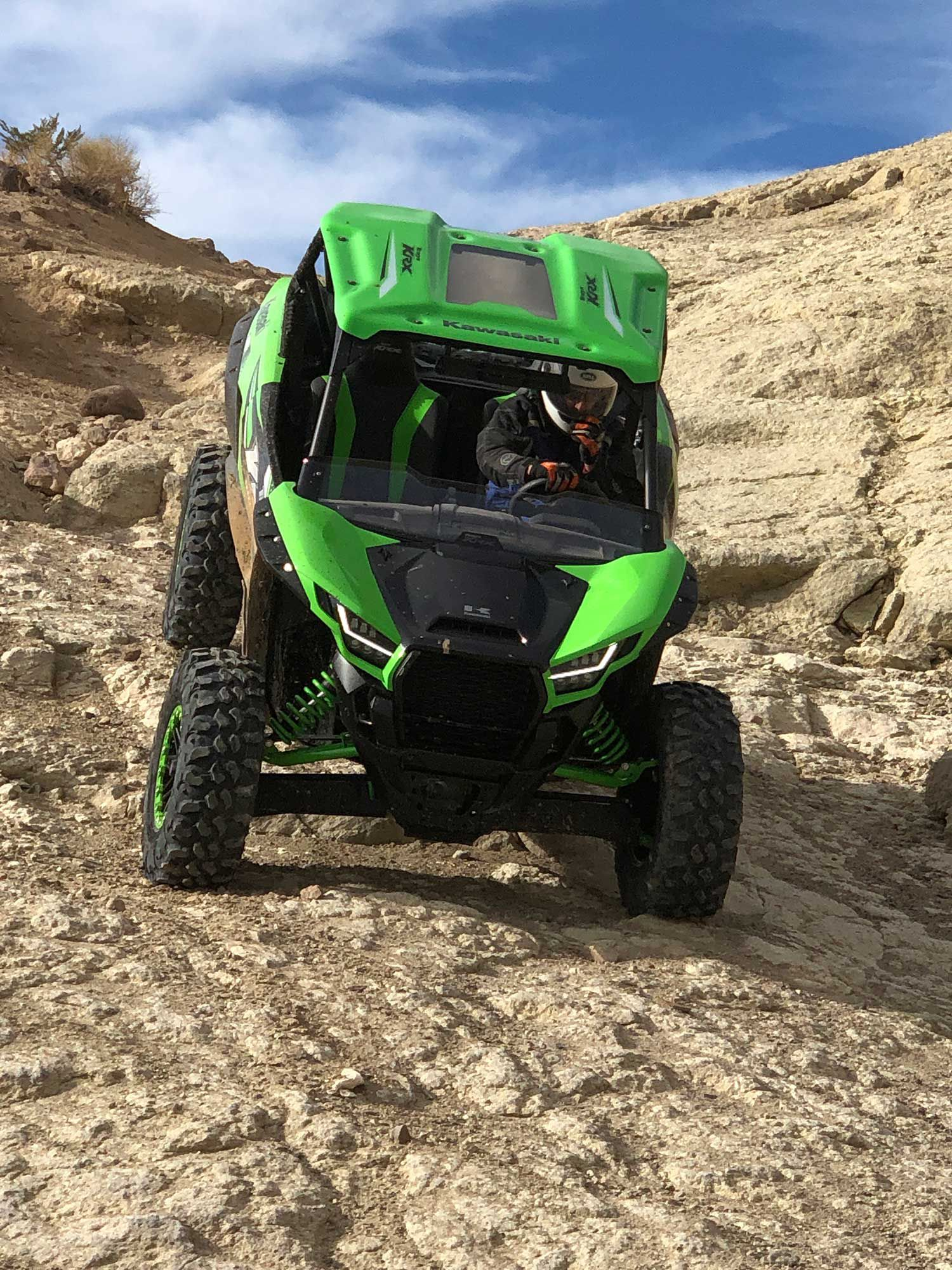 A Kawasaki rep demonstrates the proper line, speed, and rear-wheel lift on one of the more torturous downhills.
