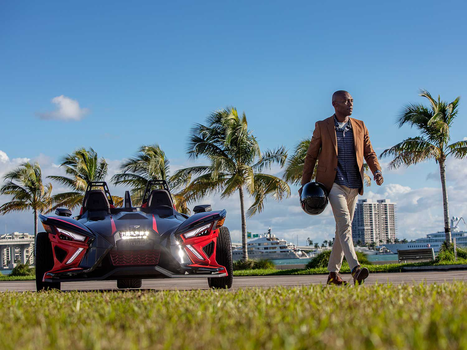 Slingshot wouldn't be a lifestyle product without an accessory package, and the so-called Design Series (seen in the foreground) adds a painted front grille, tinted wind deflector, special paint, and Slingshade roof enclosure.