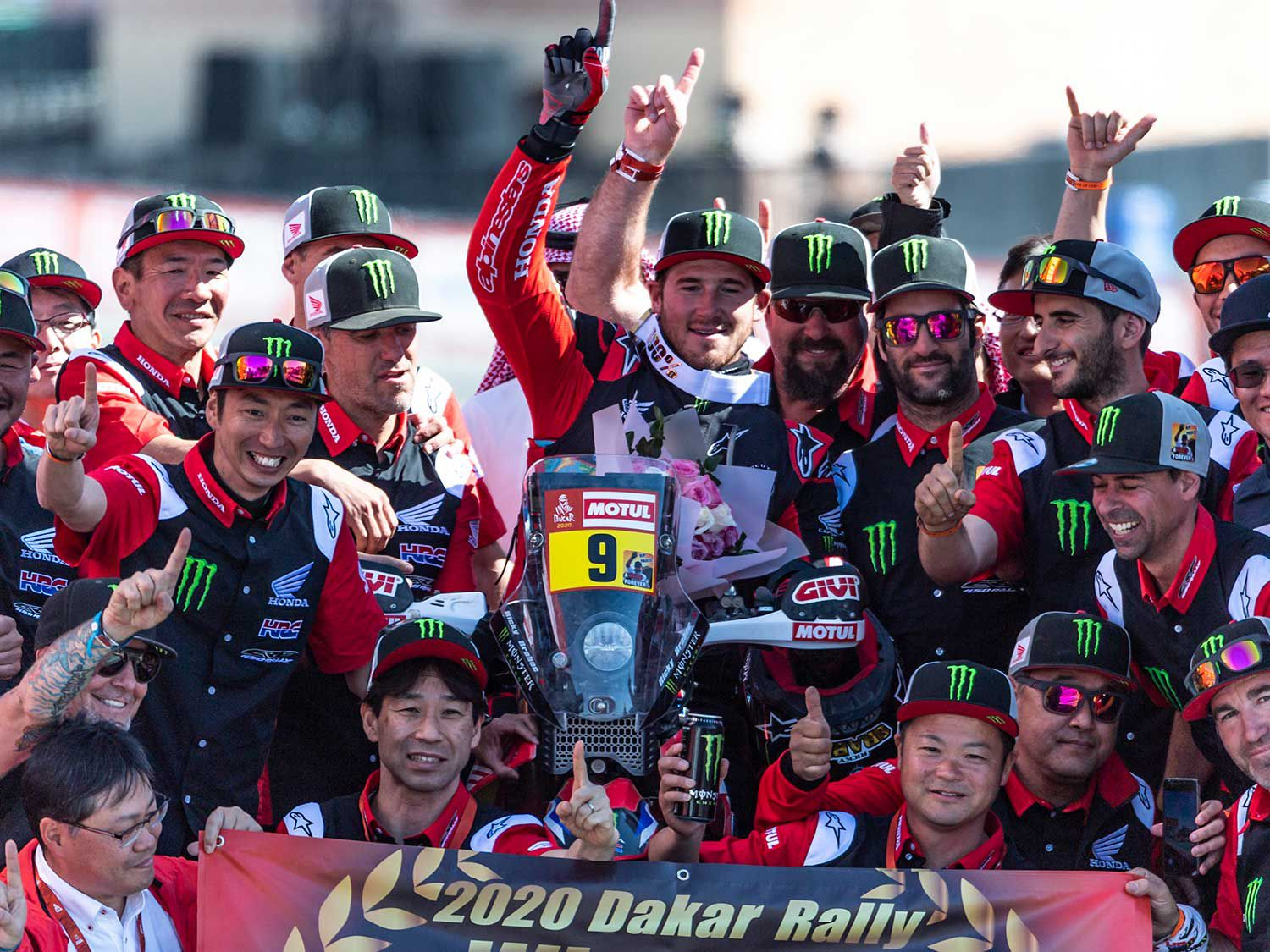 Ricky Brabec celebrates his victory at the 2020 Dakar Rally with the rest of his Monster Honda Factory Racing Team in Saudi Arabia.