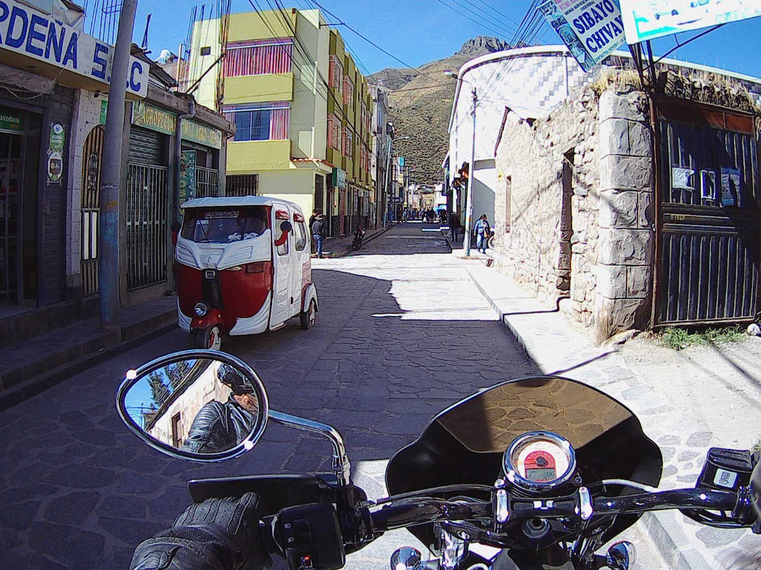 Riding through the narrow streets of a chilly mountain town.