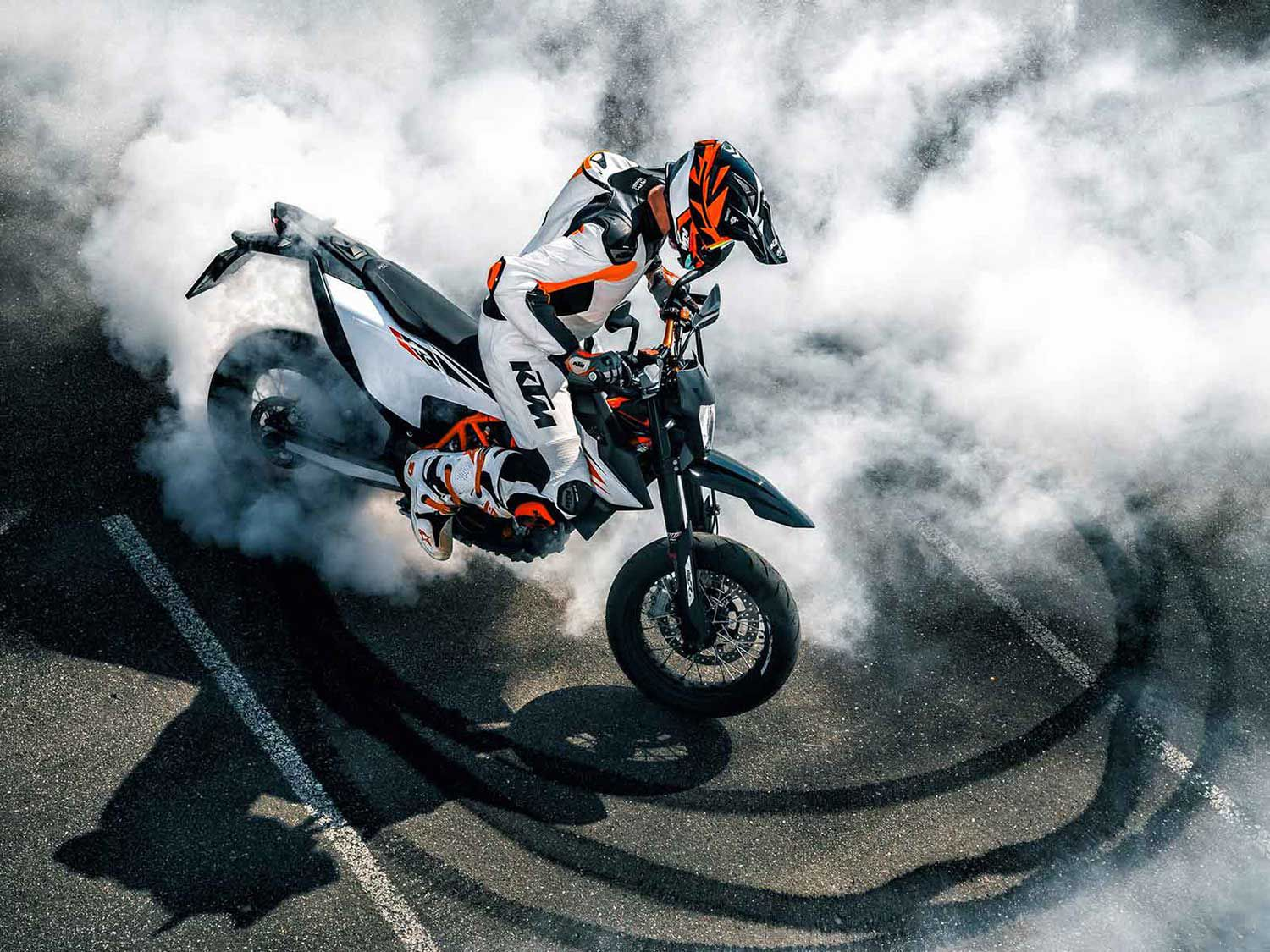 A KTM 690 SMC R in its natural habitat, amid burnt rubber and tire smoke.
