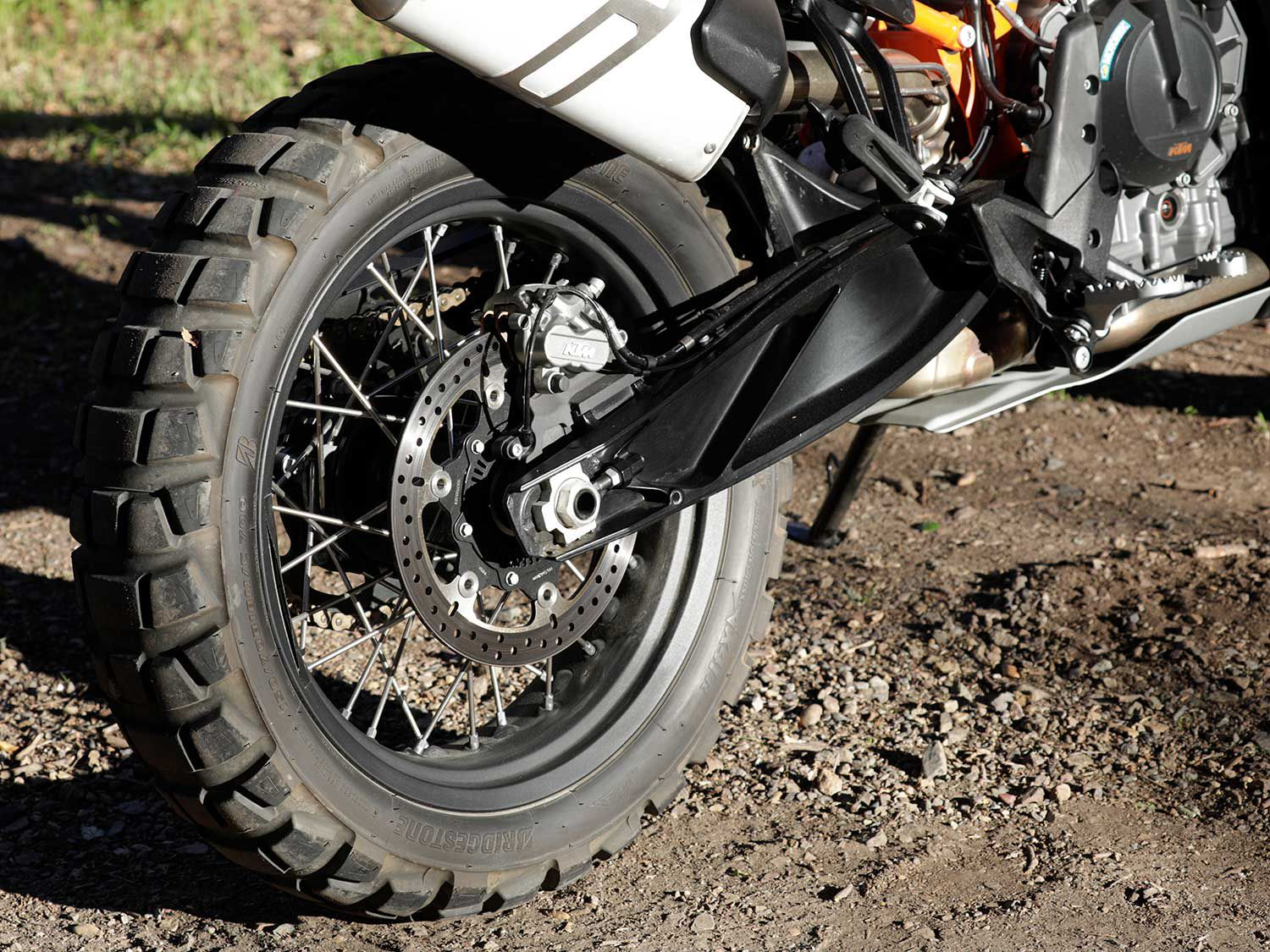Ready for adventure. The 790 Adventure rolls on a real off-road-sized 18-inch rear wheel. Note the double-piston rear brake caliper that delivers a high degree of feel when off roading.