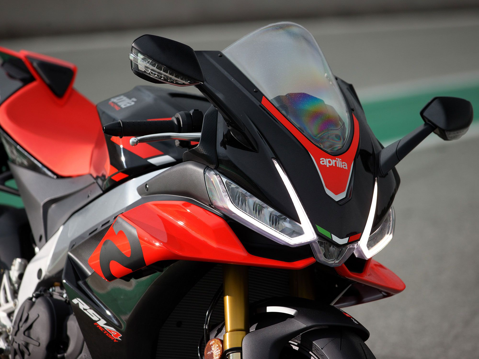 The RSV4's front fairing is broader, which better shields the rider in the tucked position.