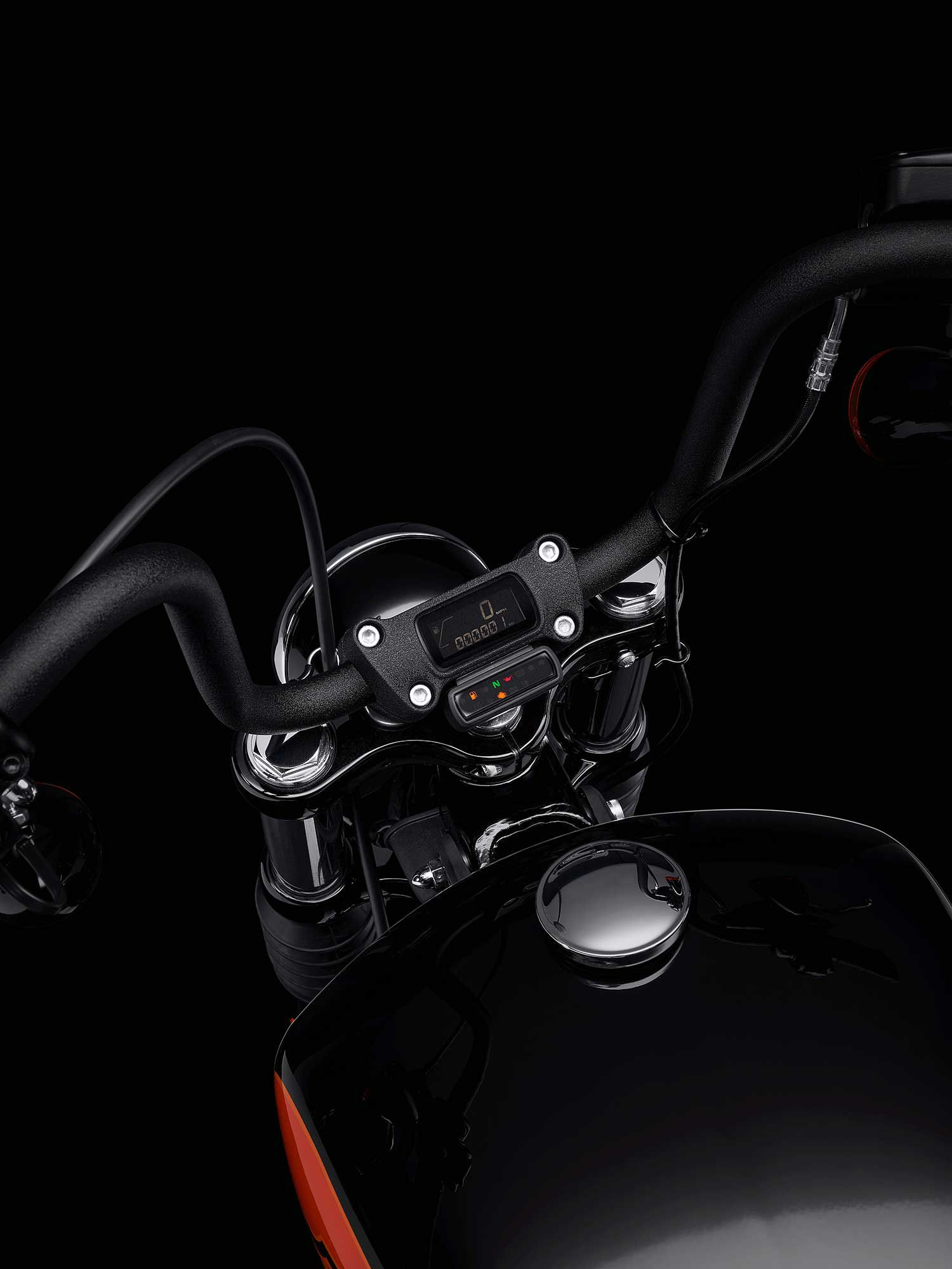 The low-profile LCD instrument panel is inset in the handlebar riser.
