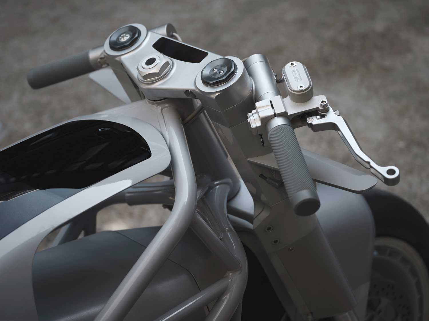 "The speedometer is integrated into the custom CNC'd top bracket. The Cypher III display is incorporated into the ""tank"" which allows the rider to navigate through preset ride modes, customize 10 ride modes, set levels of power delivery and regenerative braking, much like the functionality seen on the OEM model."