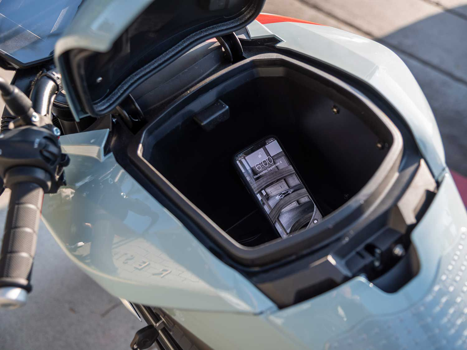 The SR/F's storage cubby can charge your phone while you zip along.