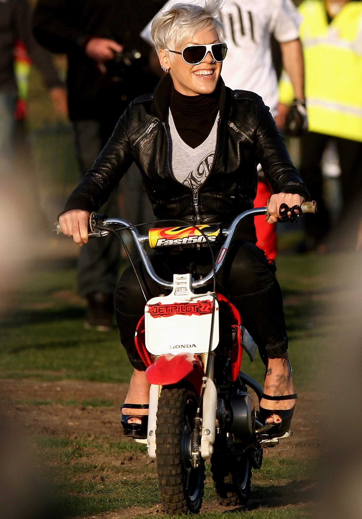 """<strong>Pink:</strong> According to a listicle by <a   href=""""https://www.ranker.com/list/celebrities-who-own-motorcycles/celebrity-lists"""">Ranker.com</a>, pop star Pink owns a Triumph Bonneville T100 and a Harley-Davidson Sportster XL Iron 883N. It also doesn't hurt that she has a built-in riding buddy with her husband, professional freestyle motocross rider and motorcycle custom builder Carey Hart."""