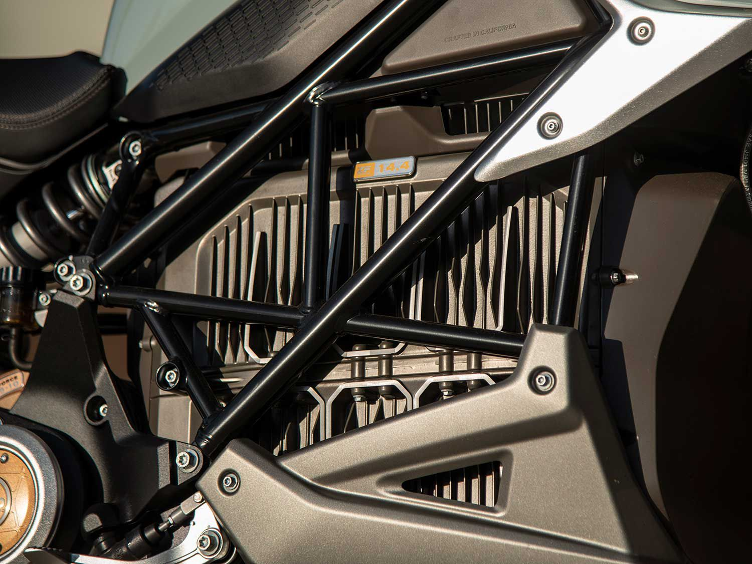The 14.4 kWh lithium-ion battery pack hides behind a steel trellis frame.