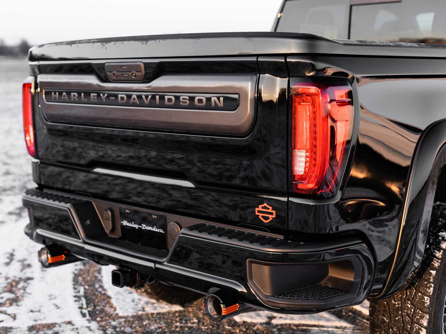 The back side of the Harley-Davidson GMC includes a custom designed rear bumper with dual H-D exhaust tips and a tailgate with a sharp-looking Harley appliqué.