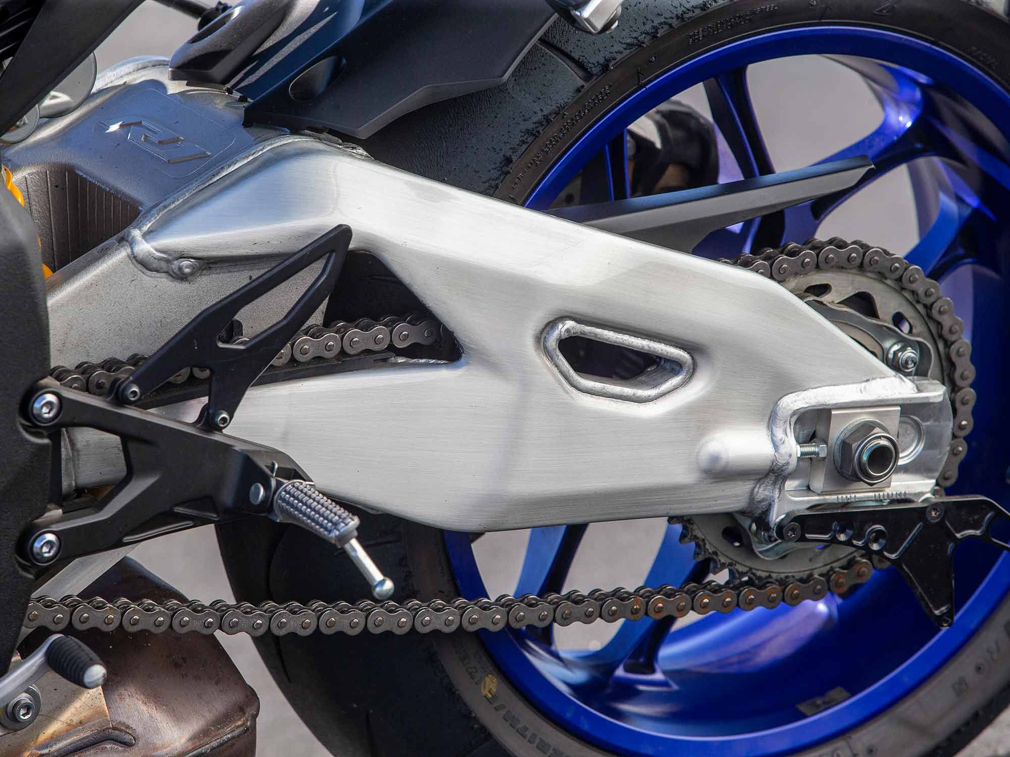 The YZF-R1M stands out with its polished aluminum swingarm versus the standard model's painted piece.