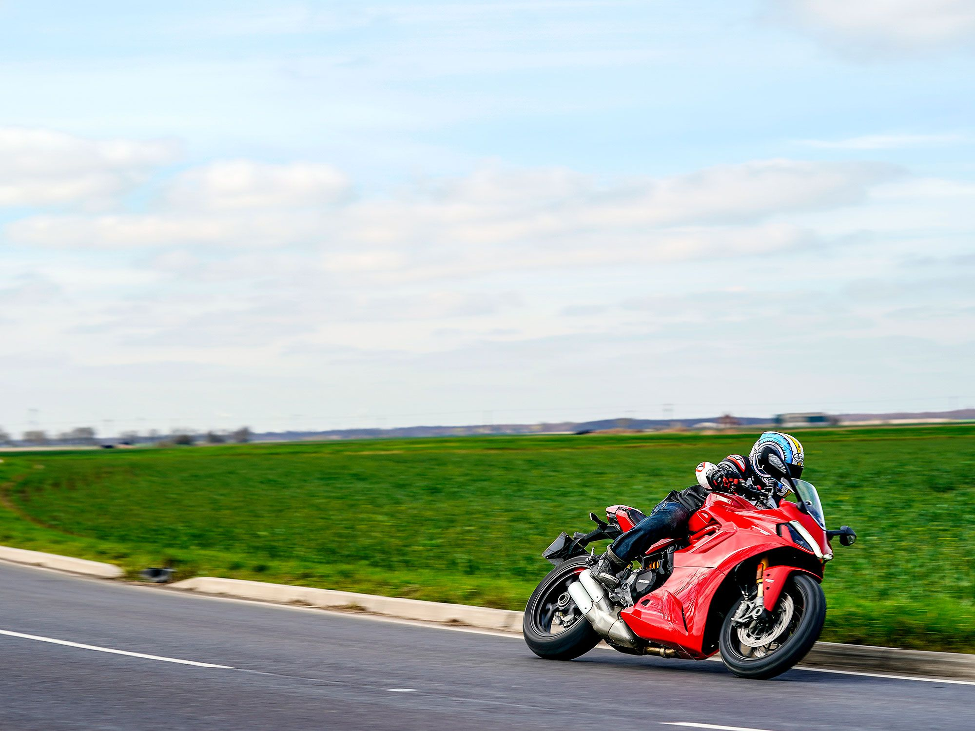 The traction control is set from 1–8 or off, Sports mode is 3, Touring 4, and Urban 6. Wheelie control is out of 1–4 and off, Sport set to 2, Touring 3, and Urban 4.