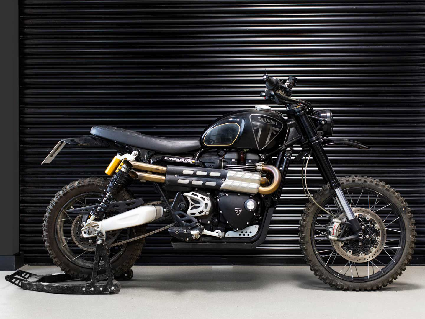 Now this looks like something Steve McQueen would ride! The Scrambler 1200 has already proved itself in stock trim at the NORRA Mexican 1000, so it should suit James Bond just fine.