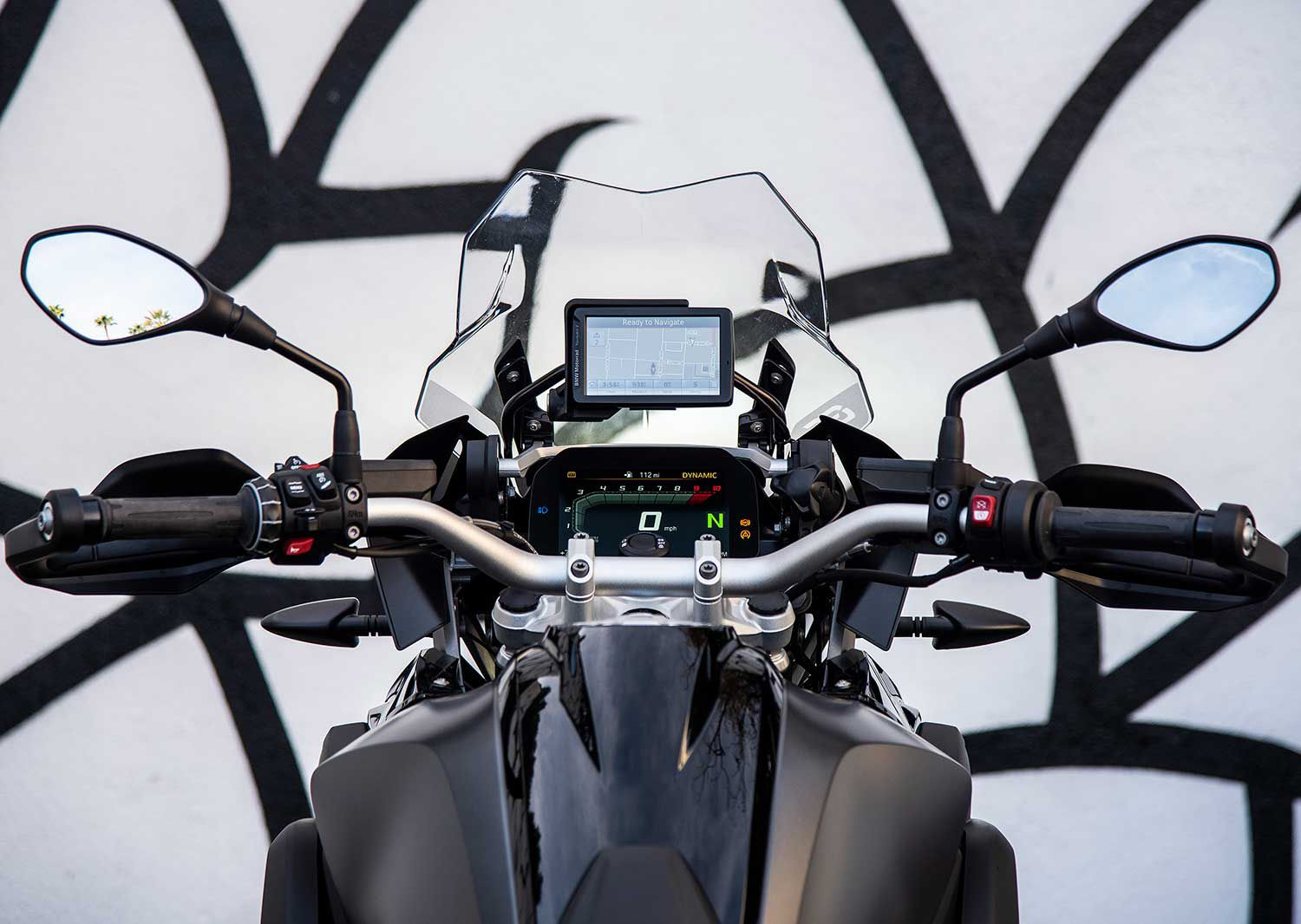 The cockpit view, with the windshield in its lowest setting, reveals a relatively compact set of controls despite the relative heft of the bike.