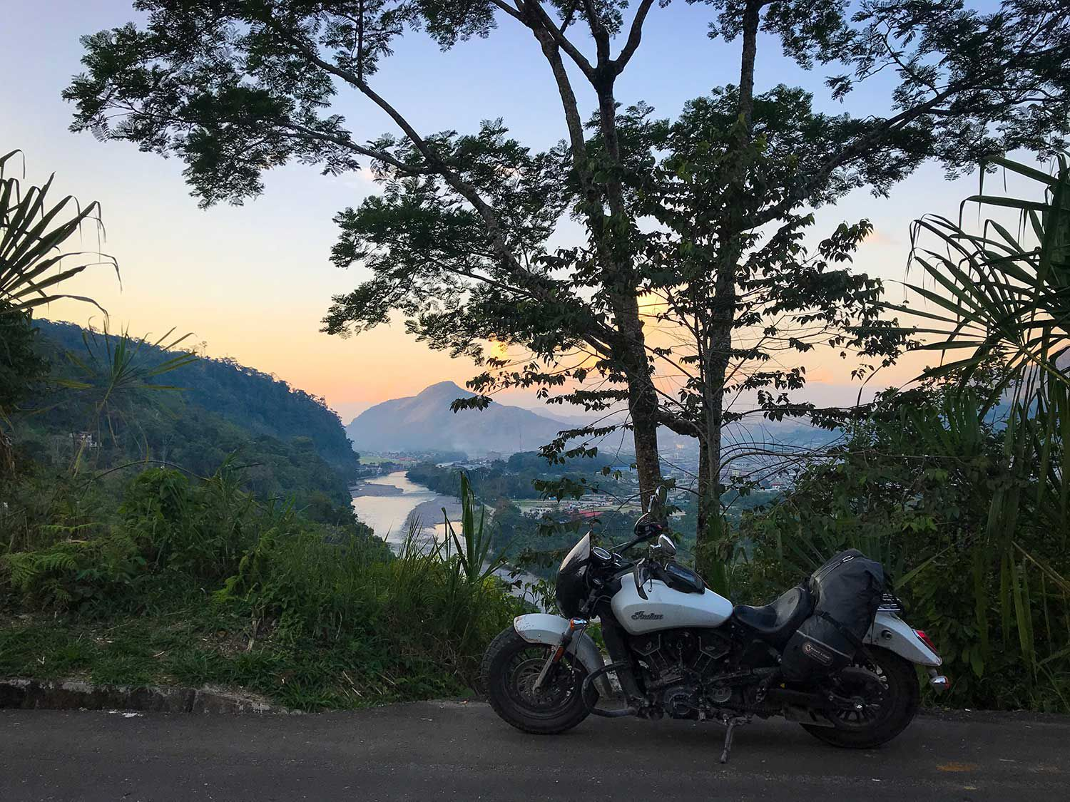 Riding an Indian Scout Sixty into the sunset on the Huallaga River, gateway to the Amazon.