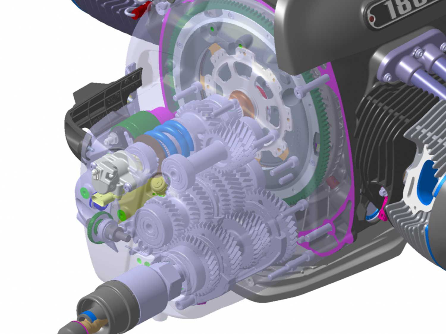 The six-speed transmission is housed in a separate aluminum housing at the rear of the main engine housing.