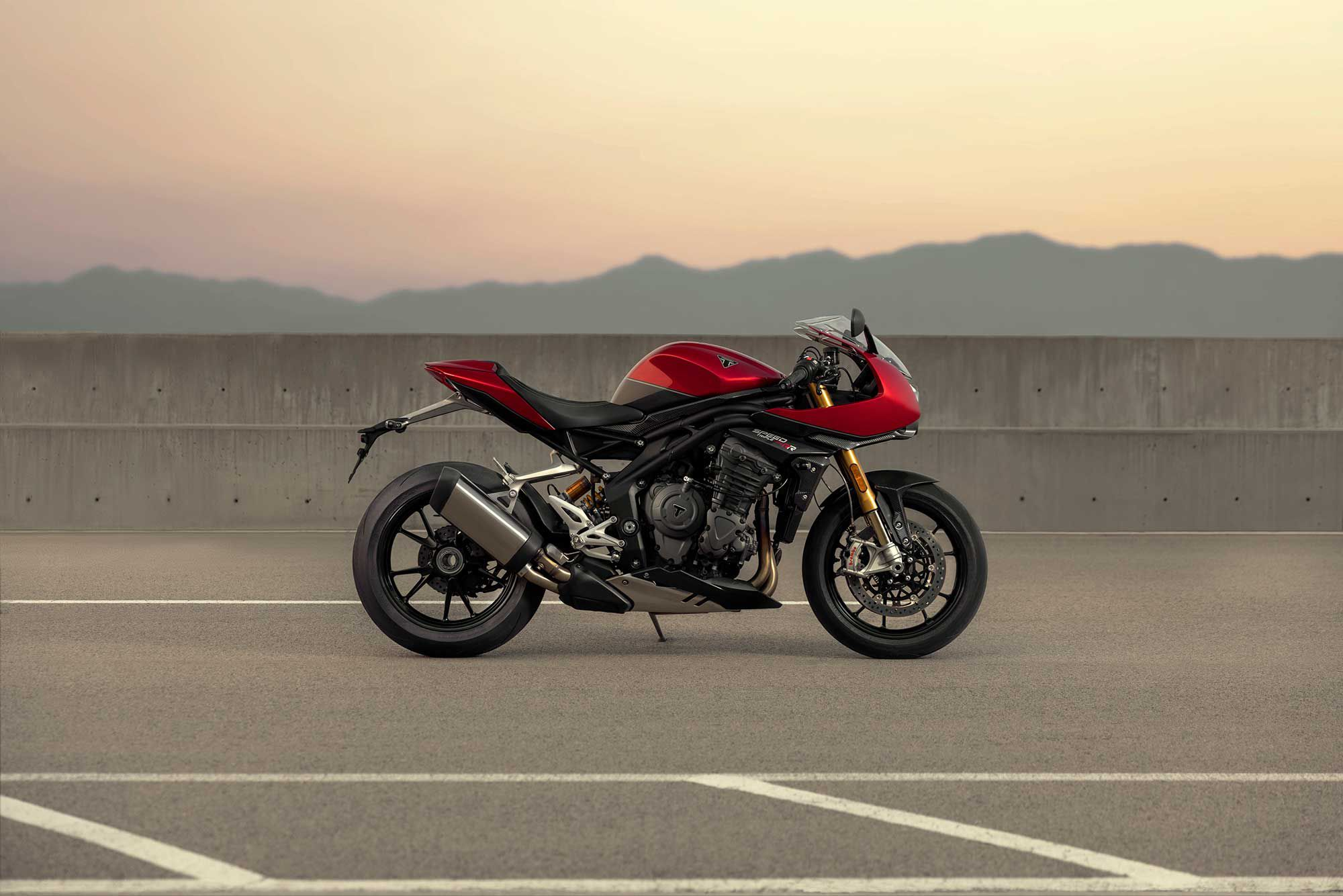 Triumph blends nods to cafe styling with an aggressive, sportbike stance.