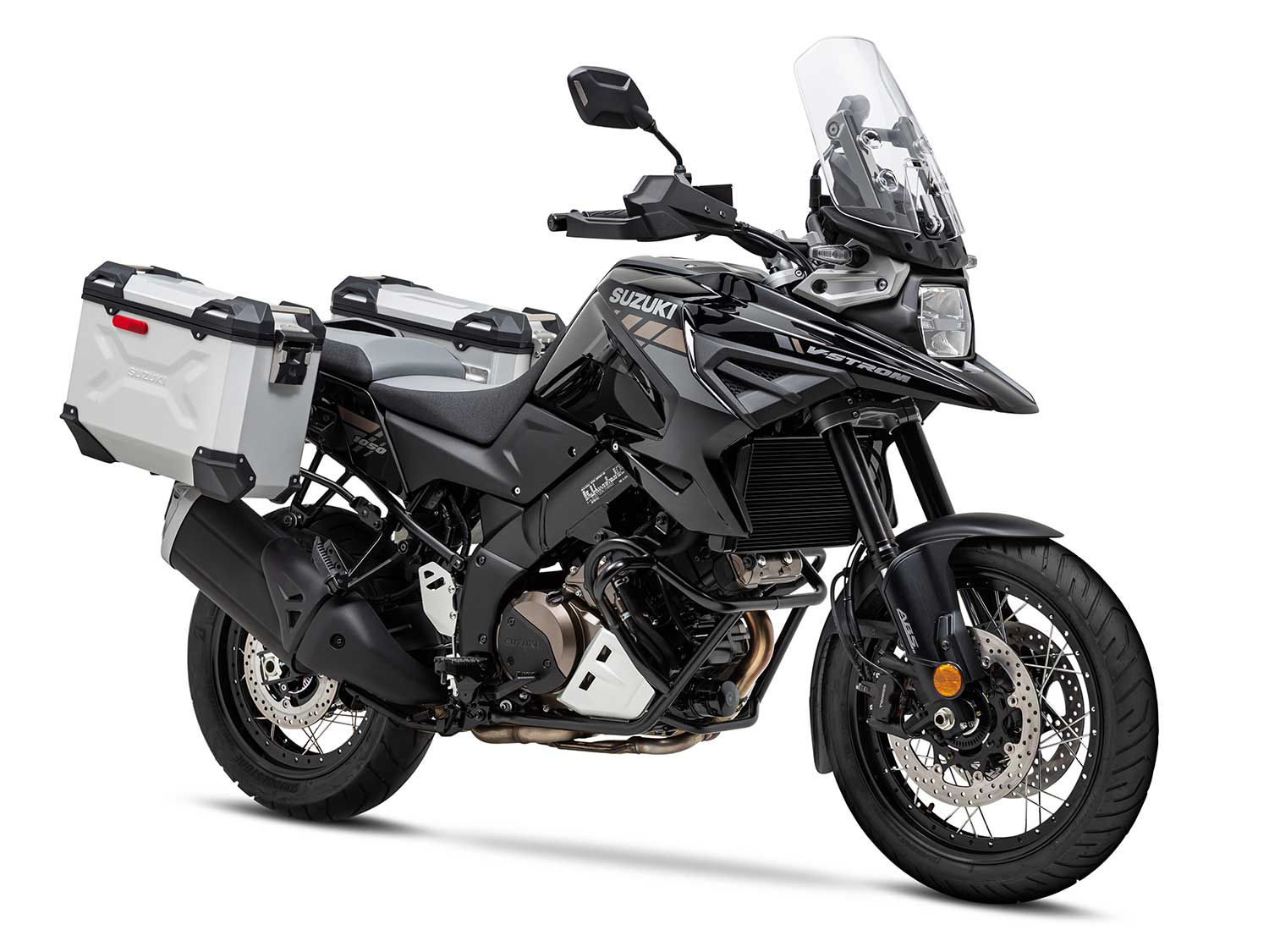 <h2>Suzuki 1050XT Adventure</h2> </br> In addition to spoked wheels, the 1050XT Adventure is equipped with heated grips and key-matched panniers.