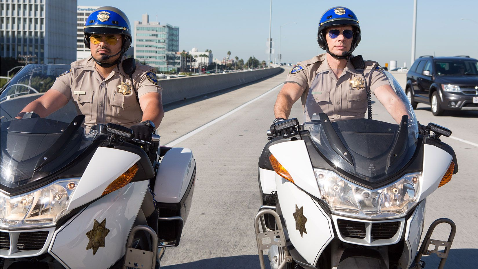 """<strong>Actor Dax Shepard:</strong> Dax Shepard saddled up for the role as CHP officer Jon Baker in the comedy <em>CHiPs</em>. He and co-star Michael Peña are shown here aboard BMW R 1200 RTs. GoSeeTalk interviewed Shepard where he stated, """"My first love is motorsports, far above movies or comedy."""""""