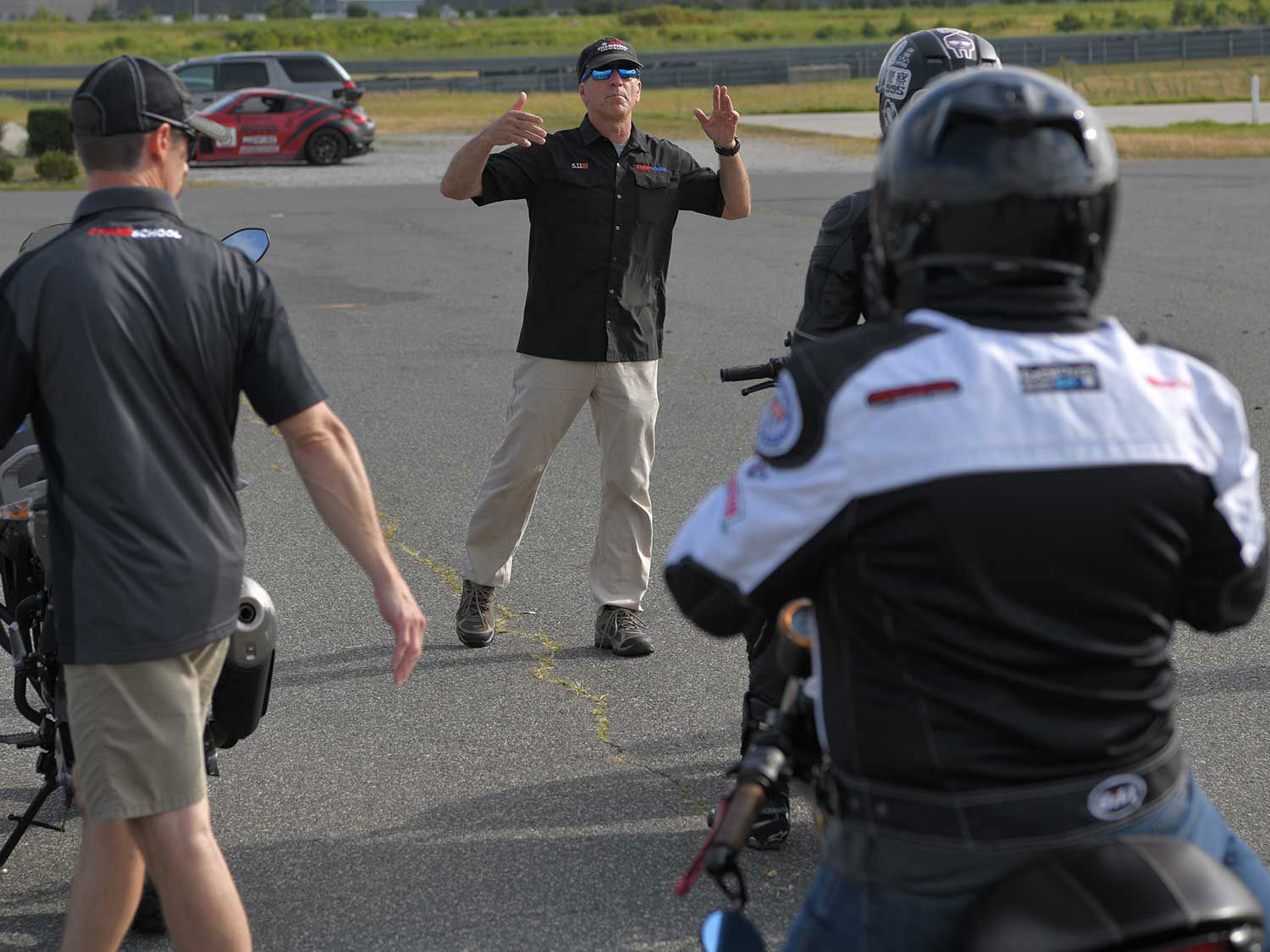 Ienatsch talking with riders during ChampStreet, a one-day class focused on getting street riders comfortable with correct riding techniques.