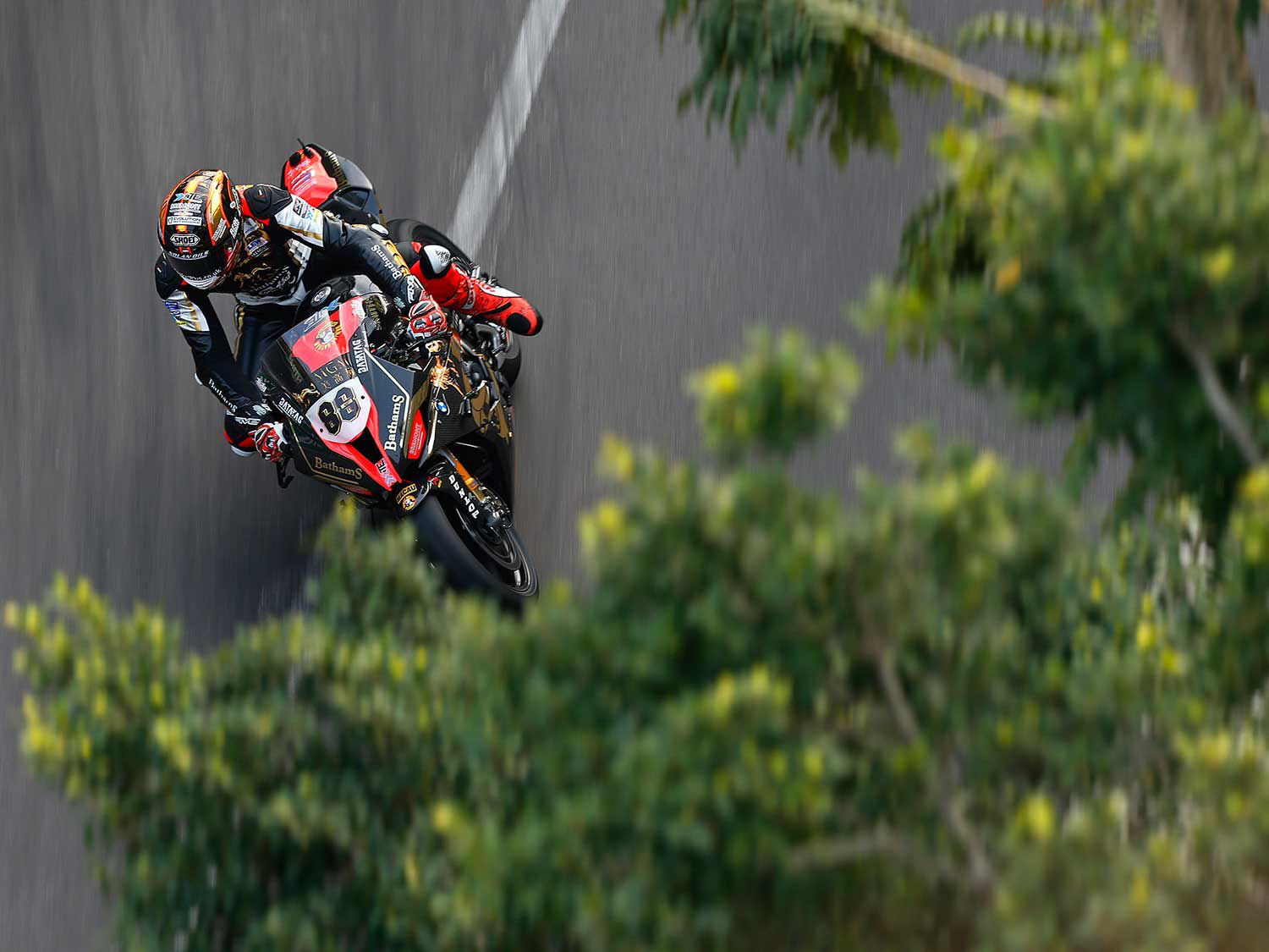 Peter Hickman (BMW Bathams Racing) photographed from the roof of a house on the streets turned racetrack in Macau.
