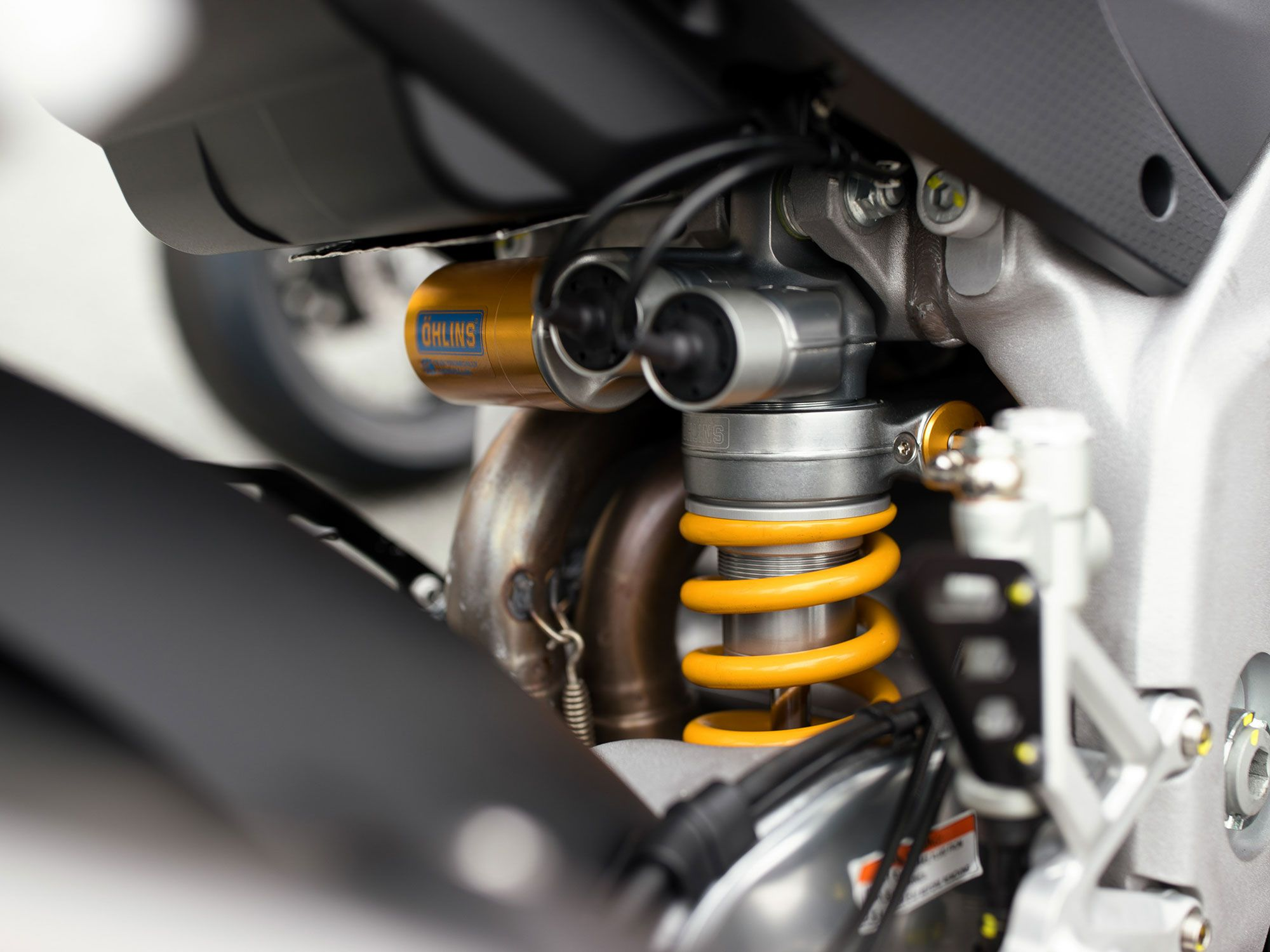 The Factory's semi-active Öhlins suspenders help take the guesswork out of suspension setup.