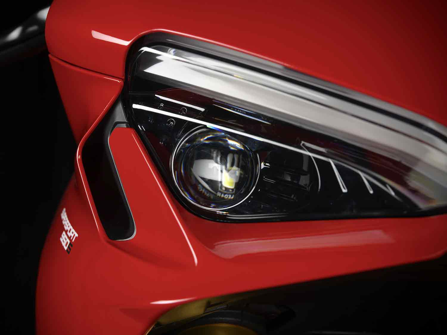 Big LED headlights peek out from beneath the new DRL.