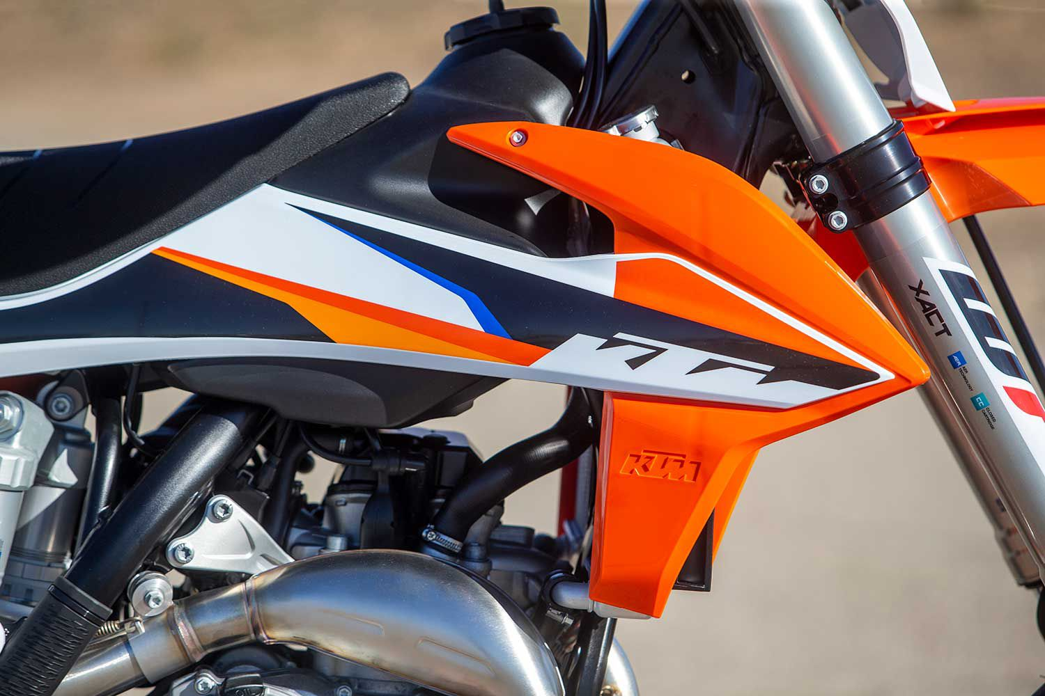 The 450 SMR's body panels make for a motorcycle that fits well and is easier to control. The 1.8-gallon fuel tank is good for a few hours of track riding fun.
