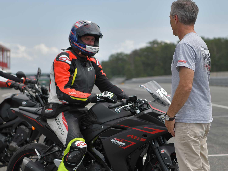 Ienatsch and instructor Mark Schellinger in pit lane.