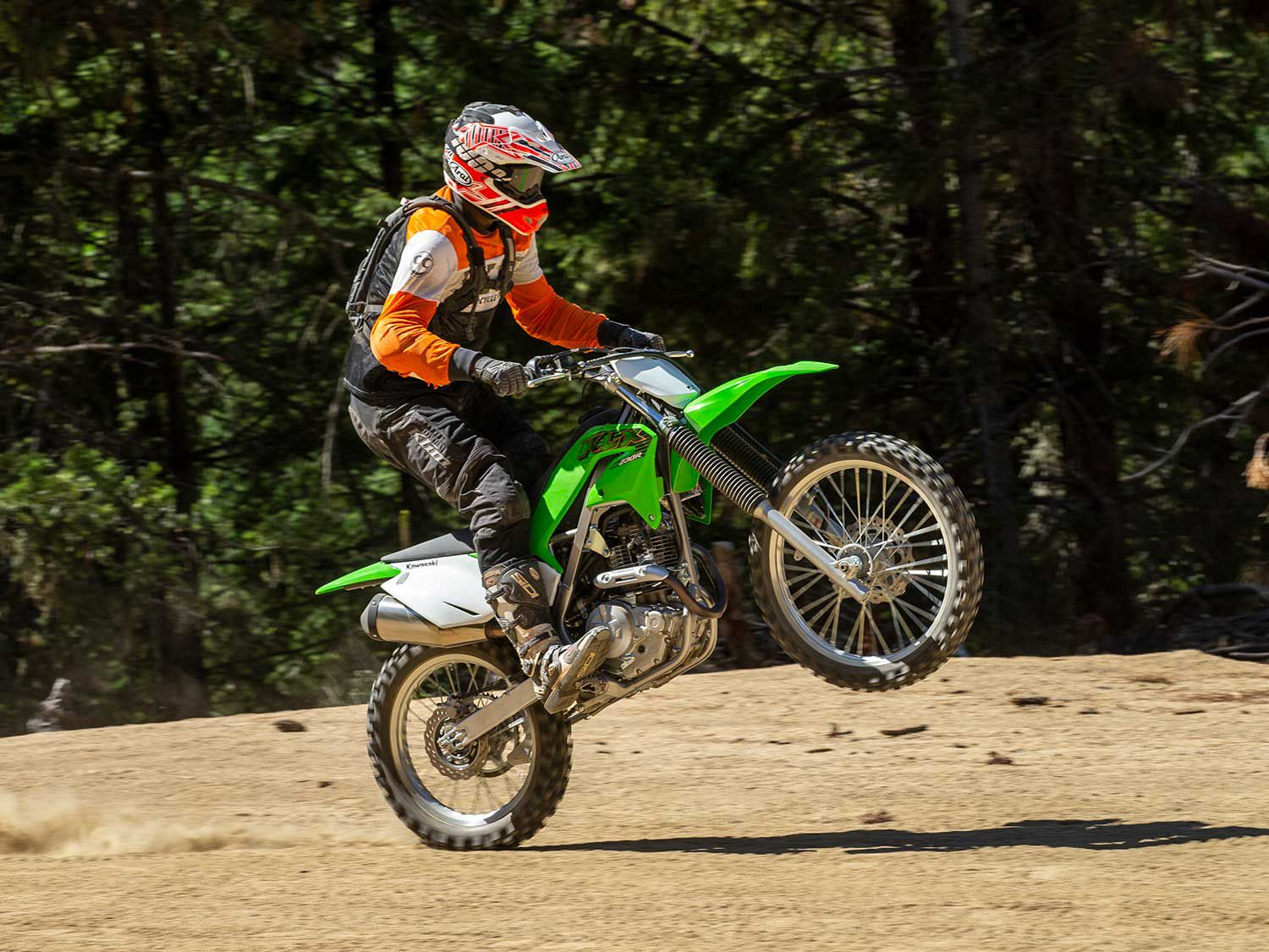 With a 40-pound weight loss and nicer suspension, the KLX230R is much easier to land a jump with.