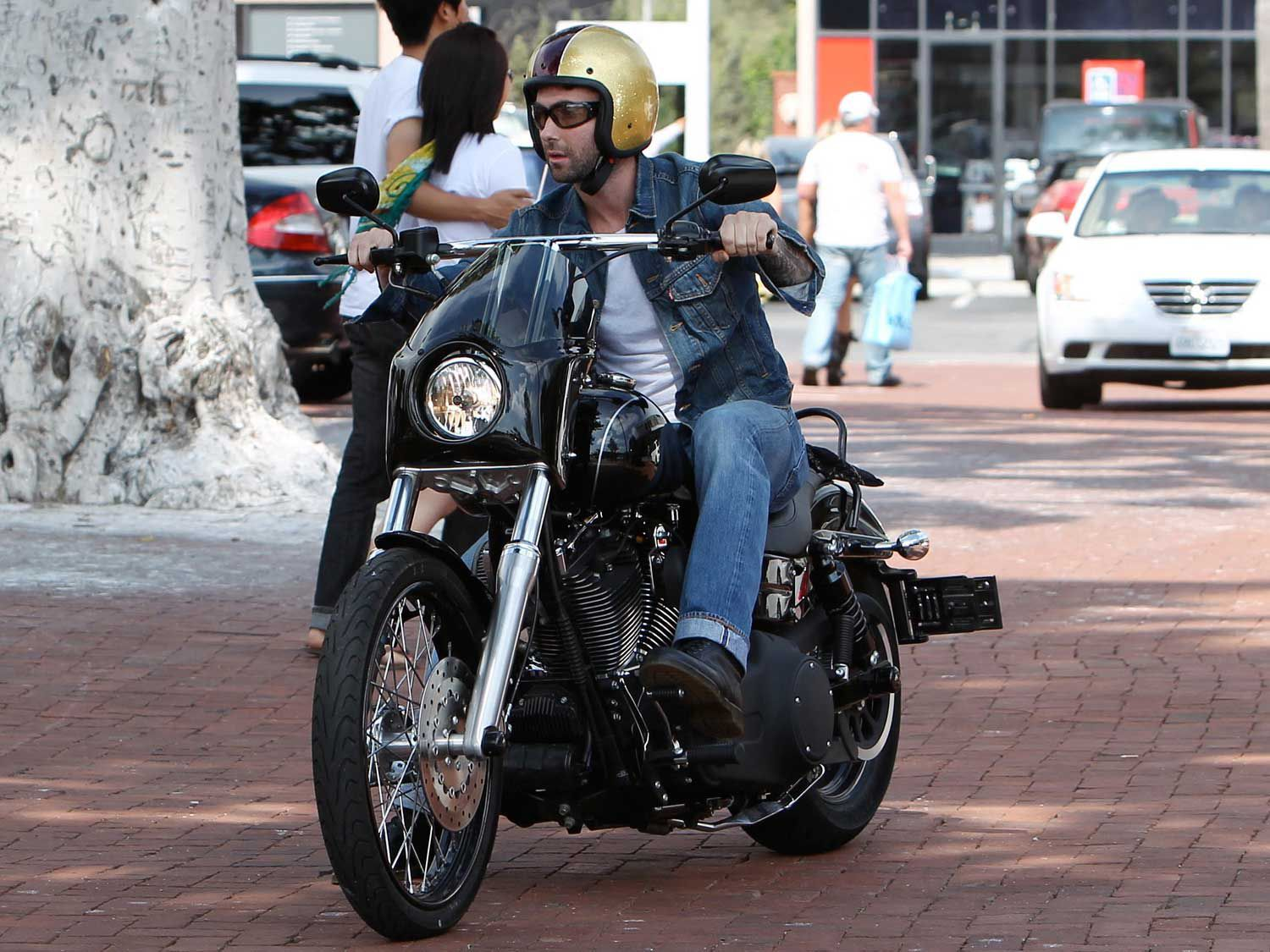 """<strong>Maroon 5 Singer Adam Levine:</strong> Did you know the Maroon 5 singer and """"The Voice"""" host swings a leg over two wheels? You can find quite a few videos of him taking his motorcycles for rides in Hollywood. This shot is of him in Malibu on a <a   href=""""https://www.motorcyclistonline.com/new-harley-davidson-motorcycles/"""">Harley-Davidson</a>."""