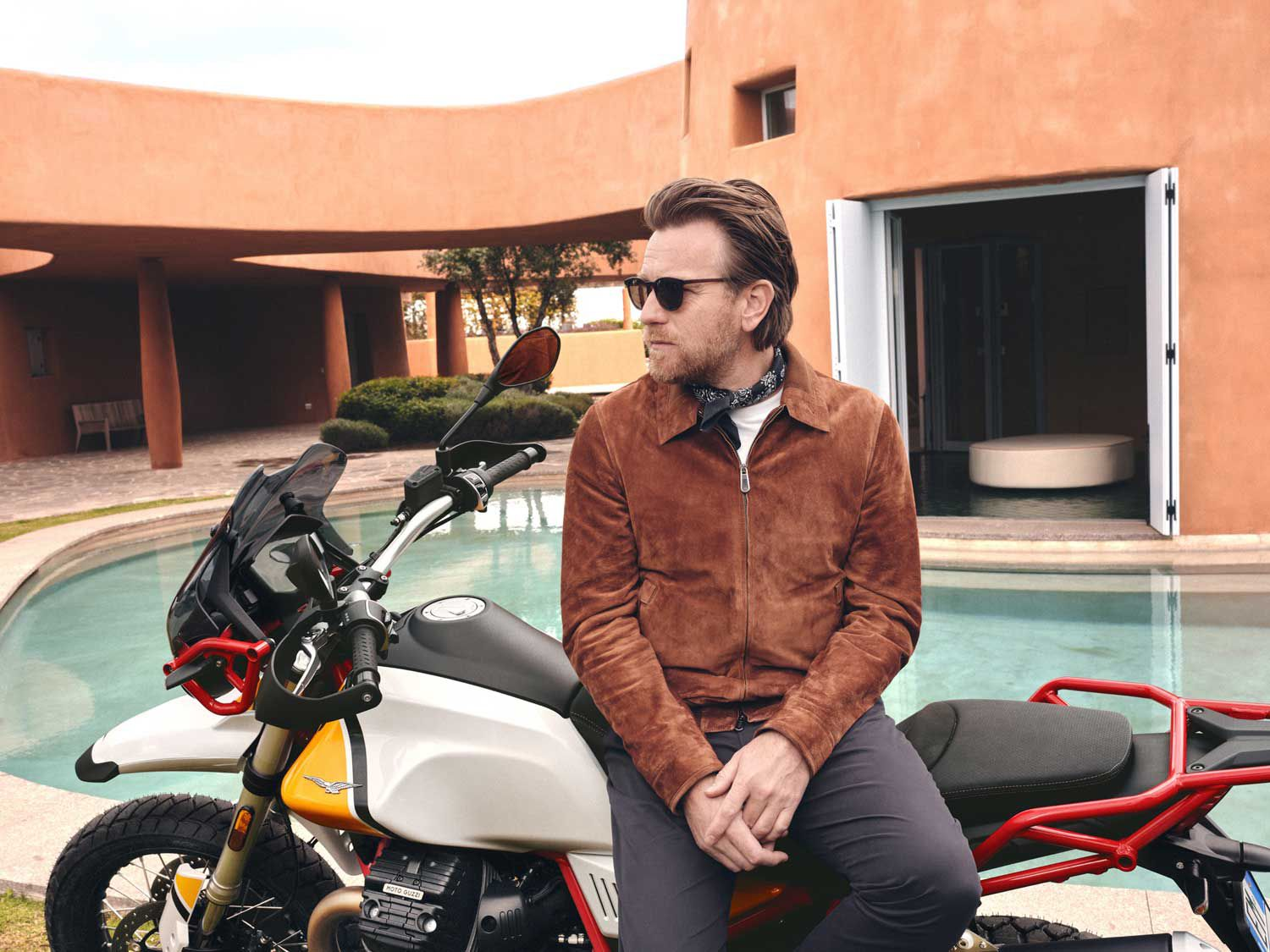 """<strong>Actor Ewan McGregor:</strong> In 2013, Ewan McGregor was part of a Moto Guzzi ad campaign and has owned at least 10 Moto Guzzis. In fact, in May, Moto Guzzi announced the actor as the ambassador for the V85TT. You might also remember that he made a 19,000-mile trip around the world with Charley Boorman in the """"Long Way Round"""" series."""