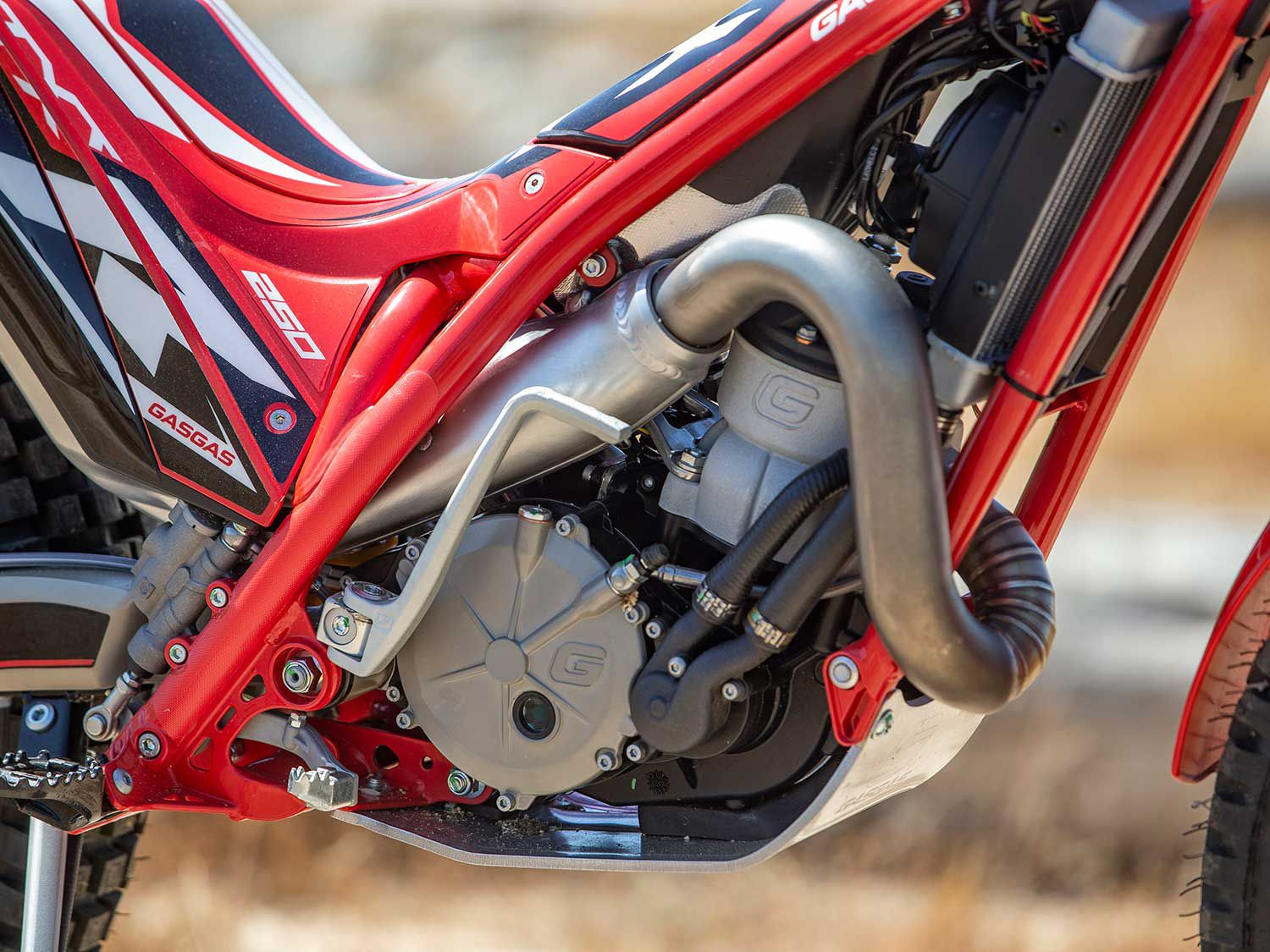 The TXT Racing 250 is powered by a 248cc liquid-cooled two-stroke single. A manual kickstarter and a twist of the throttle (it is carbureted) let the engine fire.