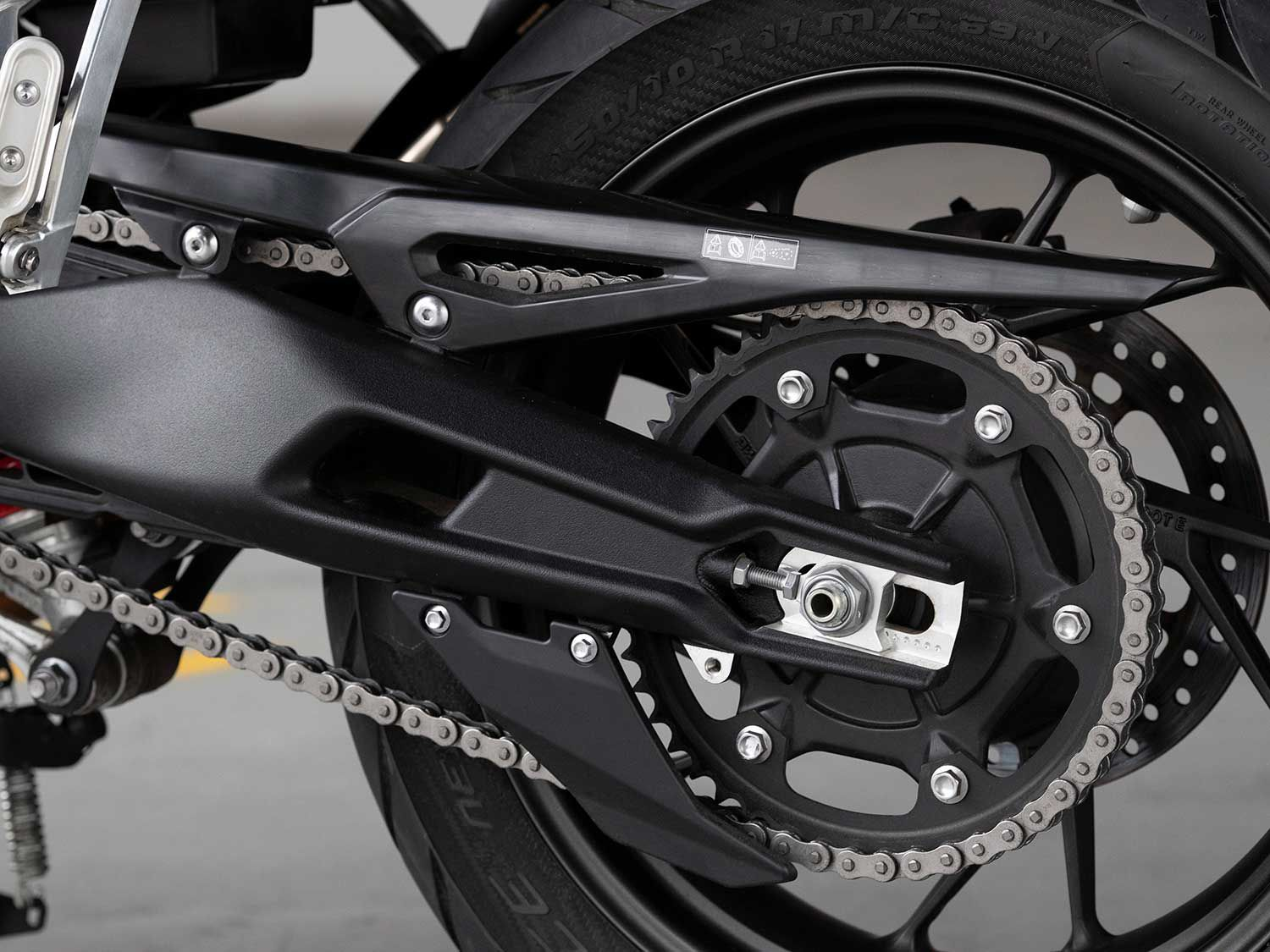 A cast alloy swingarm and left-hand-side chain final drive put power to the rear wheel.