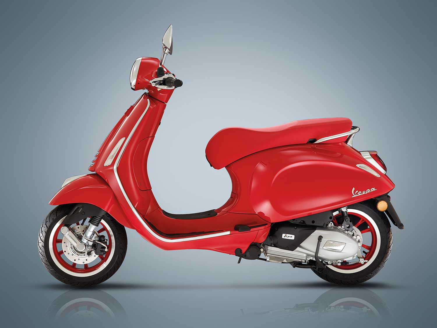 <h2>2020 Vespa Primavera 125</h2> </br> The Vespa Primavera 125 (RED) signifies the fundraising partnership between Vespa and (RED) in the fight against AIDS.