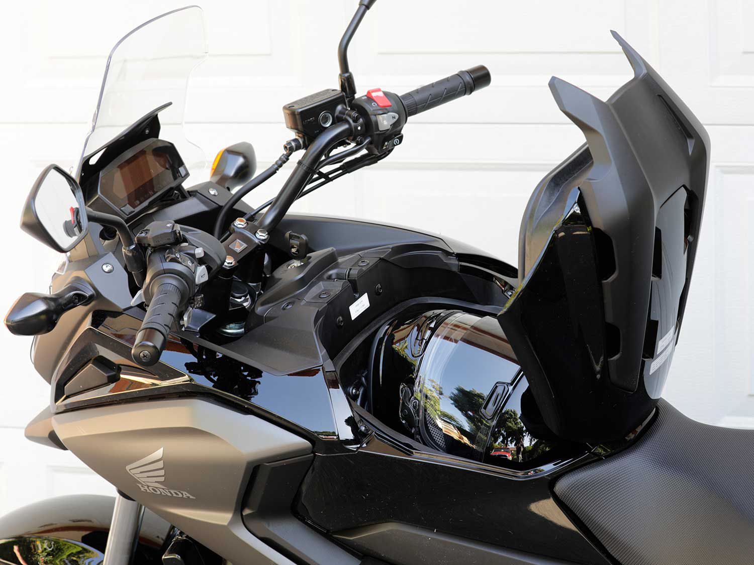 One of our favorite features is the NC750X's lockable storage compartment capable of swallowing a full-face motorcycle helmet.