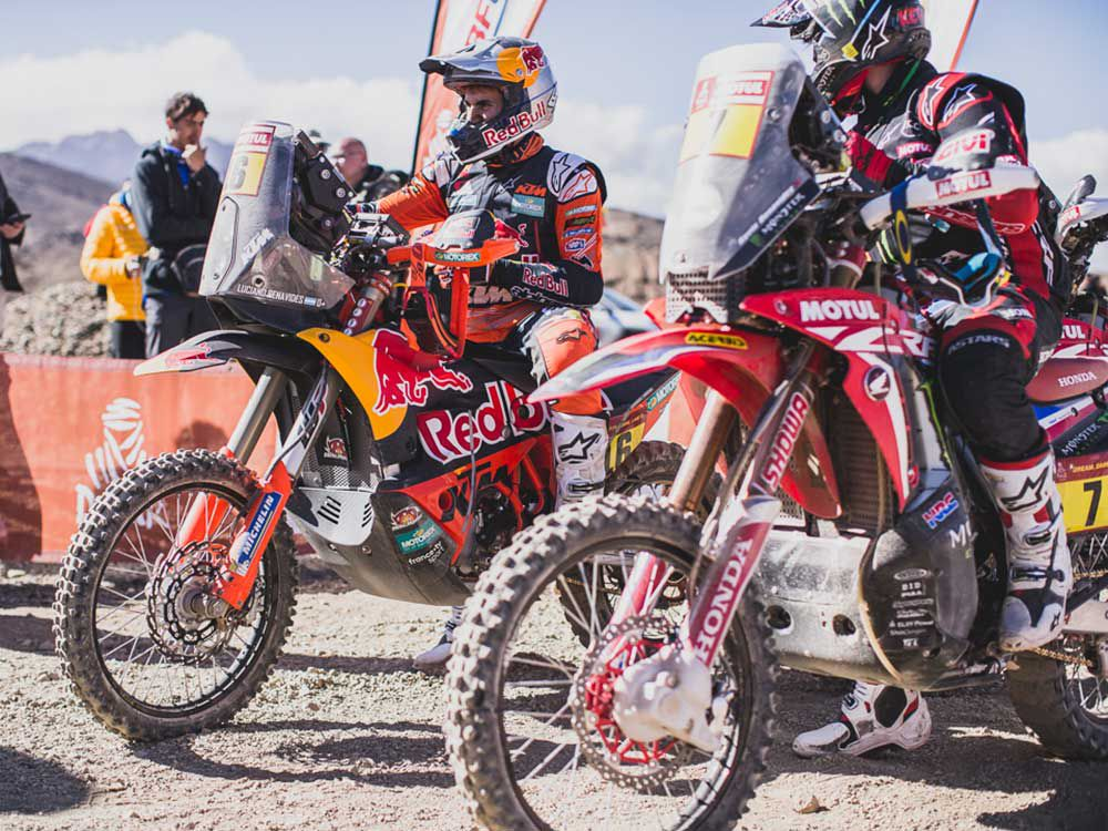 Racers relax at the finish line after hours of battling for position during Stage 3 of Rally Dakar 2020.