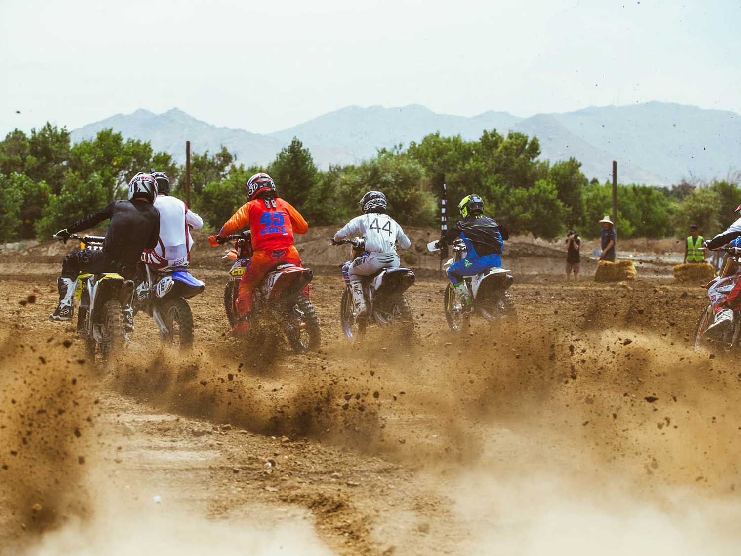 Racers jump from the starting gate during the moto race at Milestone Motocross Park.